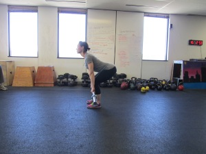 Melissa from CF Phoenix Rising demos the setup for a Deadlift