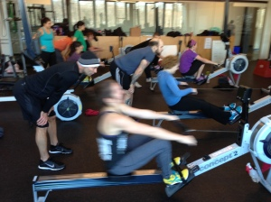 Athletes from CFH2O getting after a partner 2k at the Renegade Rowing Workshop!