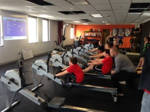 A middle school athlete getting after his first race ever at the Renegade Rowing League!
