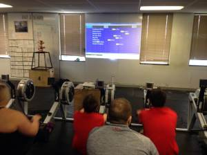 The Virtual Boats projected on the wall at the Renegade Rowing League on Saturday!