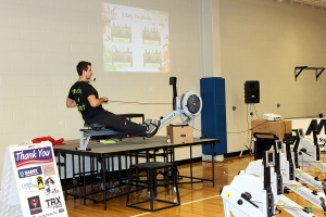 Coach Pat up on stage at the Newport Navy Base Rowing Workshop